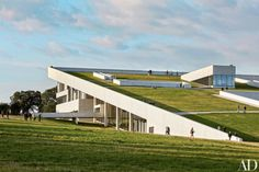 Moesgaard Museum, Aarhus, Denmark. With a sloping green roof that merges with the surrounding terrain, this wedge-shaped museum of archeology and ethnography appears to have lifted out of the earth.