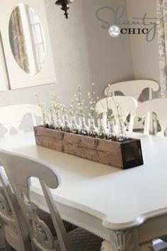 crate filled with glass bottles for vases