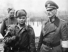 Soviet army child soldier posing with a German army prisoner, Berlin 1945