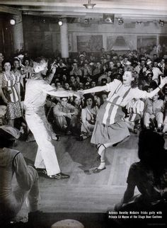 """""""Actress Dorothy McGuire frisks gaily with Private Ed Maron at the Stage Door Canteen"""" - July 27, 1942. LIFE"""
