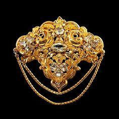 BROSCH, guld, 11 krysoberyller ca 8.50 ct. Österrike- Ungern 1800-talets senare hälft, vikt 14 g.