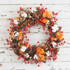 Bella Marie's Fall Cotton Orange Berry Wreath is designed with using artificial rich orange berries, natural pine cones, and artificial cotton and leaves. This wreath is simple, rustic and unique. Use