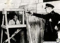 Bulletproof glass, demonstration by the best rifle man of the New York police, 1931.  Bulletproof glass was actually started on during WW1 with the invention of glass tempering or dropping hot glass into water which strengthened it considerably.  However, this bulletproof glass was created by gluing plates of glass together with a rubber compound in between the layers.  Not shown: the proceeding five test subjects for whom things did not go so well.
