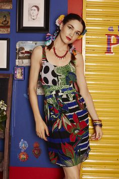 This strappy gauze dress has pleats in the waist giving it a fitted body and voluminous skirt. Be daring in this print!