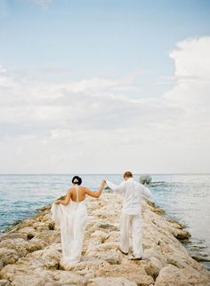 The bride and groom walking together on the beach | Photo Courtesy Jordan Brian Photography