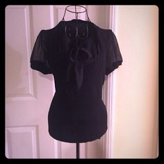 Anne Klein blouse soft, sweater- like material for the mid- section and sheer black fabric for sleeves and chest area with bow. Perfect for business attire! Anne Klein Tops Blouses