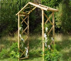 The Honeysuckle Rustic Wooden Garden Arch is formed by crossed rounded timbers, over which climbing plants can be trained.