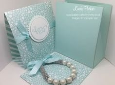 Hello Today's project is this cute triangular gift box with sleeve. I was inspired by a project I saw on You Tube by Kelly Acheso...