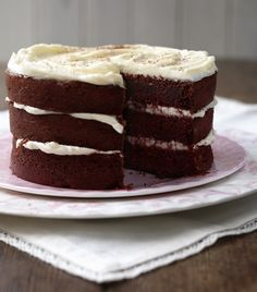 This three-layer red velvet cake with cream cheese frosting looks so impressive but it's actually really easy to make.