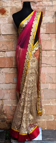 PSS166 Saree in Beige lace net pleats and fuchsia-red ombre dyes net with dabka work as pallu with oranate zari work border and olive accent To get more details, please write to info@pritisahni.com
