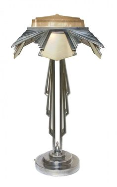 An Art Deco Style Chrome and Molded Glass Table Lamp,  the diffusers and stem with geometric decoration, raised on a stepped base.  Height overall 30 1/2 inches. Sold for $750 in 2012