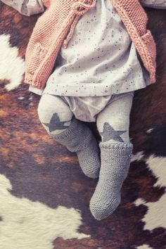 star dress and star tights with knit sweater and knit socks - cute winter look for a baby girl