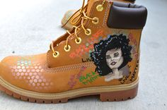 These one-of-a-kind hand-painted Timberland Classic Wheat Boots feature a beautiful girl on the outside of each shoe. The words Black Lives Matters is written over and over again in the background. This shoe is customizable to have any quote or a portrait of whoever you want. Premium full-grain and nubuck leather uppers with seam-sealed waterproof construction. Ultra-cushioned footbed and a padded ankle collar for extra comfort along with two-tone cord laces and metal eyelets. Rubber lug…