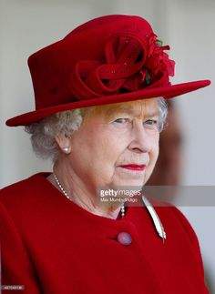 Such a deep, beautiful red hat and coat. Queen Elizabeth II attends the Braemar Gathering at The Princess Royal and Duke of Fife Memorial Park on September 5, 2015 in Braemar, Scotland.