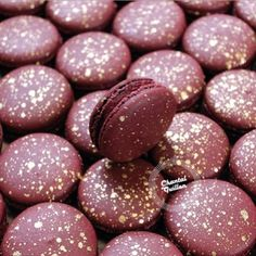 Burgundy macarons with gold flecks