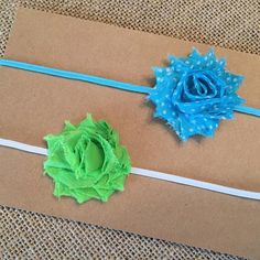 Pair of two petite shabby flowers:  Turquoise Mini Dot on a turquoise elastic band and Lime Green on a white skinny elastic band.  Available in our Etsy shop!  #turquoise #lime #headbands #shopbellejuliets #bellejulietsbowtique #etsyshop