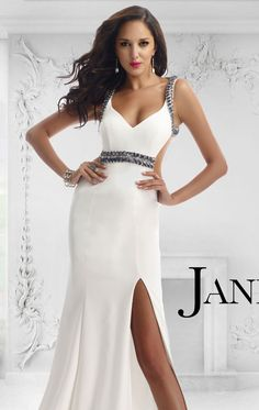 Show off your elegance in Janique W1008. This delightful evening gown features a revealing v-neckline. This dress is designed with multicolored beads that accentuates the front waist and straps that wind across the open back. The side slit boasted by the slightly flared long skirt with its sweeping train also provides a sultry peek into your gorgeous legs.