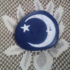 Moon and star, painted on a Lake Huron beach stone by Cindy P 2018.
