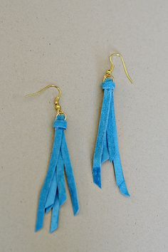 Suede Earrings.  Suede lace, earwires, jumprings, scissors, jewelry pliers, and hot glue gun.  Works for me!