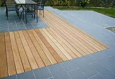 Hardwood decking next to granite paving