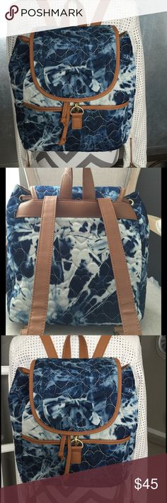 Betsey Quilted Denim Backpack This backpack has a drawstring top closure with front clip. Bottom front of backpack is a snap pocket. Inside zip pocket on back with slip pocket & 3 pen or lip gloss holders. Fully adjustable back straps. NWT Betsey Johnson Bags