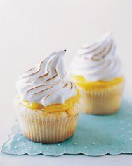 Coconut Cupcakes with Seven-Minute Frosting and Coconut Flakes Recipe | Martha Stewart