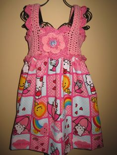 SO CUTE! This dress is all pink and whimsical, sure to be your little girls favorite. The top of this dress is crochet, made of a cotton-blend yarn, chest size approximately 20 inches. It has straps which button in the back, and is adjustable, with the 2 buttons on each one. It can be worn crossed or not, to fit longer.    The attached skirt is cotton, has a bit of elastic on the waist, so it stretches somewhat. It is 14 inches longer, making the dress a total of 17 inches from under the…