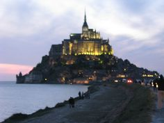 "Mont Saint-Michel , France .   The "" Wonder of the Western World"" forms a tower in the heart of an immense bay invaded by the highest tides in Europe."