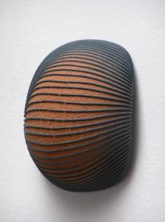 These uniquely textured ceramic pieces are by German artist Enno Jäkel. To see more of his work go to his website.