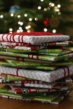 Wrap up twenty-five Christmas children's books and put them under the tree with a special Christmas quilt or blanket next to them. Before bed each evening, your kids choose one book to open and read together until Christmas.  Love it! #tradition