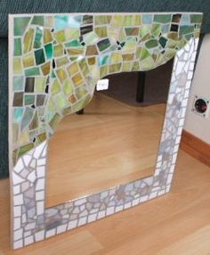 stained glass mirror idea: I like how the glass/tile covers some of the mirror