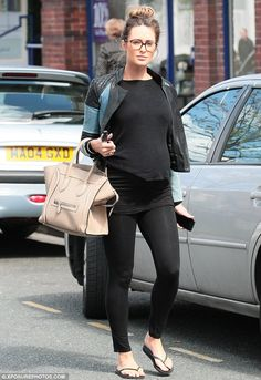 Mixing it up: Georgina Dorsett experimented with her maternity style with a pair of geek chic-inspired glasses as she stepped out in Wilmslow, Cheshire, on Friday morning
