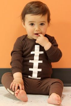 Learn how to make a baby football costume out of a onesie.