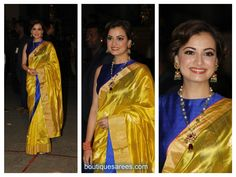Bollywood and south indian actress diya mirza graced in traditional raw mango silk saree at 60th Britannia Filmfare Awards 2015. paired with zari border with all over zari motifs teamed with contrast cobalt blue sleeveless high neck pattern she finished out the look with pearl chain with jhumka earrings.