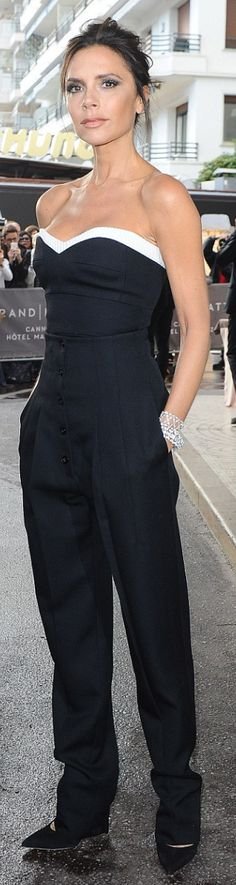 Who made Victoria Beckham's jewelry, black pants, and white sweetheart top?