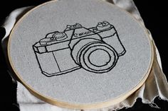 DIY: vintage camera embroidery. I would love for someone to make this for me on a pillow someday.