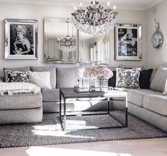 Living Room Decor Ideas   Glamorous, Chic In Grey And Pink Color Palette  With Sectional Sofa, Graphic Black White Photography And Crystal Chandelier.
