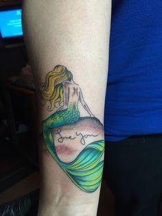 Mermaid tattoo on wrist by Audrey Mello