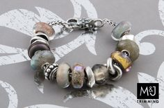 Loooove all the warm grays and silvers in this bracelet! Like a cloudy day.