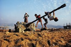 Discarded weapons of war become a playground for children in Lebanon --Portraits of Resilience by professional photographer, Steve McCurry