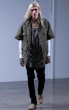 Fear of God third collection look book , shor sleave military jacket layered with striped tank top and arm sleeves paired with black trousers and Chelsea boots