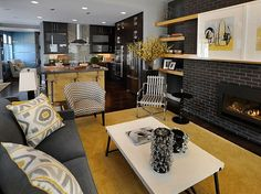 Smart open plan living room . . . black, ivory and mustard gives the contemporary scheme a '60s feel.
