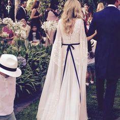 Boho lace wedding dress with bow detail. The boho bride.