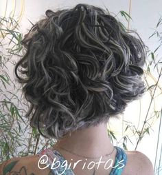 curly short black bob with blonde highlights