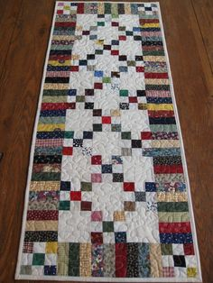 Scrappy nine patch tablerunner.