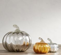 Handblown of recycled glass by skilled artisans, our pumpkins are then dipped and painted by hand for a shimmering finish. Place our one-of-a-kind pumpkins on a console or coffee table to add an elevated seasonal touch to a room. #Affiliate