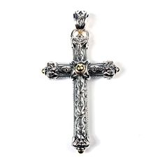 One 18K Yellow Gold and Sterling #ScottKay Silver Cross.