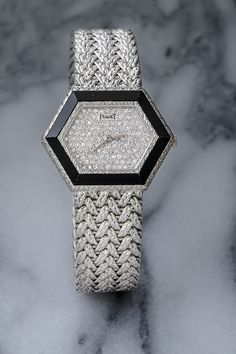 Fitted with an Onyx Bezel and Pave Diamond Dial, this Ladies Circa 1970 Piaget watch is a rare find. The watch case is particularly unique, rendered in a Hexagonal shape. Yellow Diamond Engagement Ring, Antique Engagement Rings, Watch Case, Watches, Shape, Antiques, Lady, Antiquities, Antique