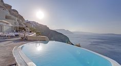 Mystique, a Luxury Collection Hotel, Santorini Oía Located on Oia's most famous cliffs, Mystique features an infinity pool with a sun deck and a bar with breathtaking views to the Volcano and the Caldera.