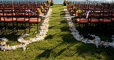 flower petal aisle with scrolls at the end... scrolls could go around the lanterns